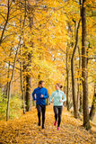 Young people jogging together in nature Stock Images