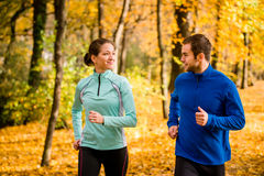Young people jogging together in nature Royalty Free Stock Image