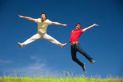 Young people jump on hill in park Royalty Free Stock Photography