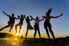 Young people jumping on the beach. Group of happy young people jumping on the beach Stock Photo