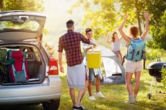 Young people just arrived on camping trip. Mood positively young people just arrived on camping trip stock image