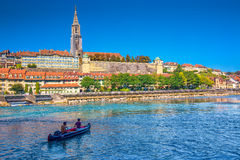Young people kayaking on Aare river in the Bern city center. BERN, SWITZERLAND - September 25, 2016 - Young people kayaking on Aare river in the Bern city royalty free stock photo