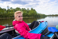 Young people are kayaking on a river in beautiful. Spring and sport picture in river kayaking Royalty Free Stock Photo