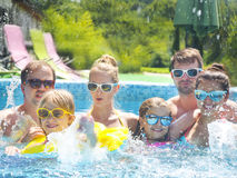 Young people with kids having fun in the swimming pool. Stock Image