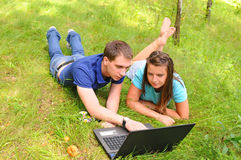 Young people with a laptop Royalty Free Stock Photos