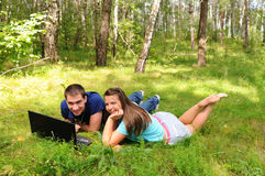 Young people with a laptop Stock Photos