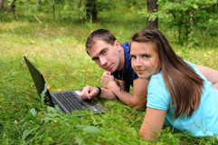 Young people with a laptop Stock Images