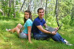 Young people with a laptop outdoors Stock Photos