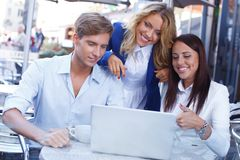 Young people with laptop Stock Photography