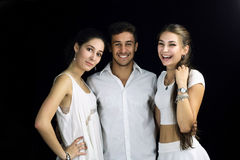 Young people laughing on black background. Young people laughing  embraced on black background Stock Photos