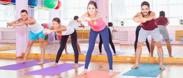 Young people lead a healthy lifestyle, exercise in fitness room Stock Photo