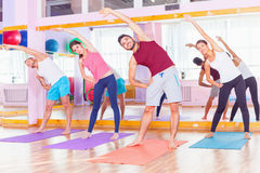 Young people lead a healthy lifestyle, exercise in fitness room Royalty Free Stock Photo