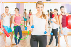 Young people lead a healthy lifestyle, exercise in fitness room Royalty Free Stock Image