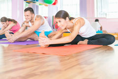 Young people lead a healthy lifestyle, exercise in fitness room Royalty Free Stock Photos