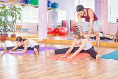 Young people lead a healthy lifestyle, exercise at fitness room Royalty Free Stock Photography