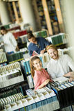 Young people in the library Royalty Free Stock Photos