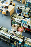 Young people in the library Stock Image