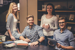 Young people in the library Royalty Free Stock Photo