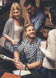 Young people in the library Royalty Free Stock Photography