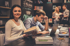 Young people in the library Stock Photos