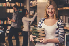 Young people in the library Stock Images