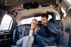 Young people in limo, making selfie Stock Images