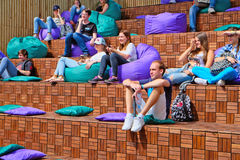 Young people listen to a lecture in the theme pavilion in city Park Stock Photography