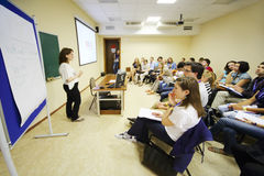 Young people listen to lecturer royalty free stock photo