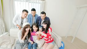 Young people look phone happily Royalty Free Stock Images