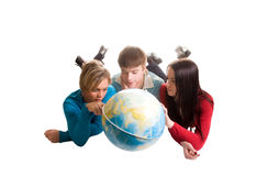 Young People Looking At Globe (isolated On White) Royalty Free Stock Photography