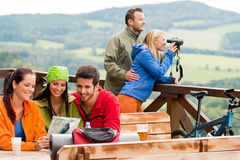 Friends hiking mountains read map look binoculars Stock Images