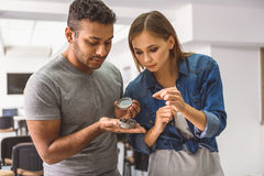 Young people looking at coffee with concentration Stock Photo