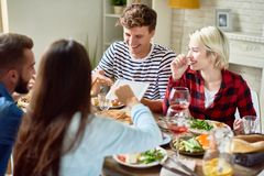 Young People Looking at Digital Tablet during Dinner royalty free stock images