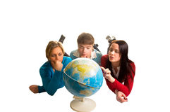 Young people looking at globe (isolated on white).  royalty free stock image