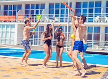 Young people looking happy dancing at swimming pool royalty free stock photos