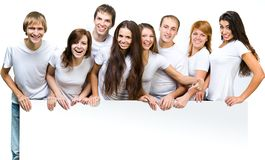 Young people looking out a board Royalty Free Stock Photography
