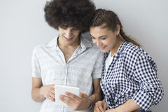 Young people looking at a tablet Royalty Free Stock Images