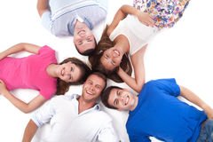 Young people lying down around Royalty Free Stock Images