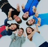 Young people lying down,gesturing thumb up sign. Young people lying down,gesturing thumb up sign Stock Photos