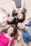Young people lying on floor Stock Photo