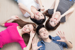 Young people lying on floor. Young people smile happily and lying on floor Stock Photos
