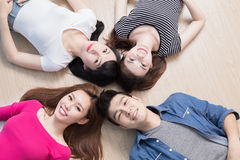 Young people lying on floor. Young people smile happily and lying on floor Royalty Free Stock Photo