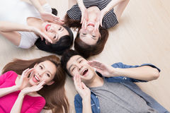Young people lying on floor. Young people smile happily and lying on floor Royalty Free Stock Images