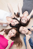 Young people lying on floor Royalty Free Stock Photos