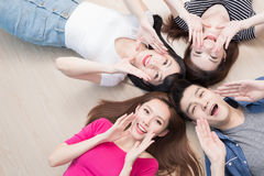 Young people lying on floor. Young people smile happily and lying on floor Stock Photography