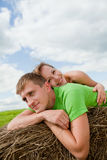 Young people lying on the hay Stock Images