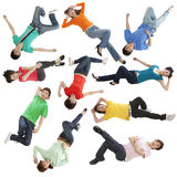 Young people lying at random Royalty Free Stock Photos