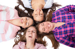 Young people lying on whitwith eyes closed smiling Royalty Free Stock Photo