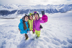 Young people are making mobile selfie ski resort Stock Image