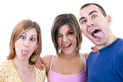 Young people making silly faces. Funny photo of three young people making silly faces Royalty Free Stock Photo